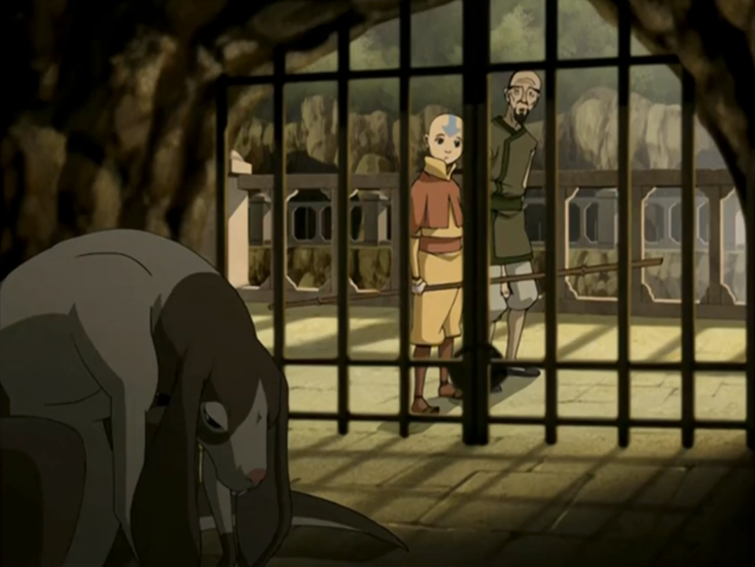 Avatar The Last Airbender Aang and a zookeeper looking at a Rabaroo in a cage